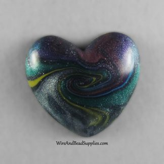 Galaxy swirl heart shaped polymer clay cabochon.