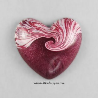 Strawberry swirl heart shaped polymer clay cabochon.