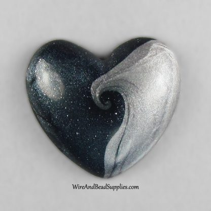 Blue and silver swirls heart shaped polymer clay cabochon.