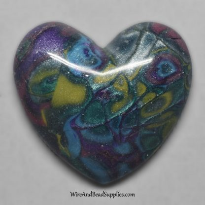 Handmade polymer clay mokume gane cabochon in yellow, green, purple and blue.