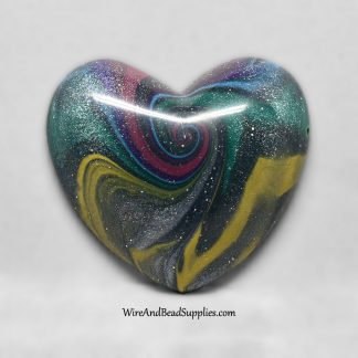 Dark rainbow swirl heart shaped polymer clay cabochon.