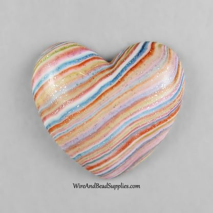 Striped heart handmade polymer clay cabochon.