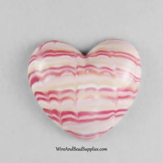 Pink striped heart handmade polymer clay cabochon.