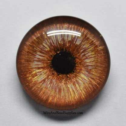 Brown hand painted glass eye cabochon.