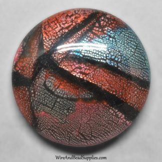 Red, blue, pink, silver and black mosaic round polymer clay cabochon.