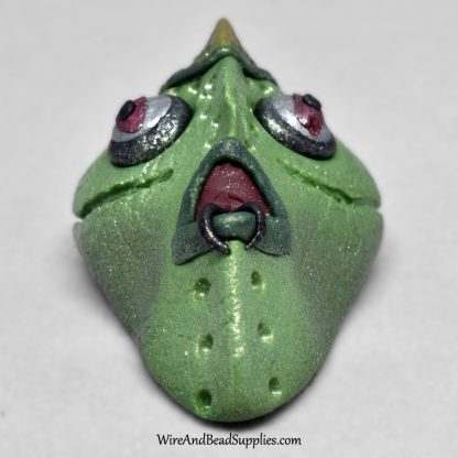 Bug eyed green alien face cabochon.
