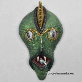 Silver tongued devil alien face cabochon.